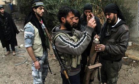 """هذه حقيقة علاقة الحكومة الأمريكية بـ""""داعش"""" وهكذا يصطاد رهائنه"""