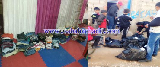 إلتفاتة دفأ عنوان مبادرة توزيع مجموعة من الملابس على الأطفال وقاطني حي عين الدفلة 03